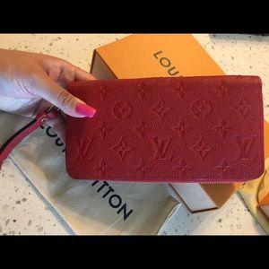 Authentic Louis Vuitton Empreinte Zippy